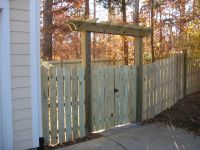 13_wood_pergola_over_double_gate